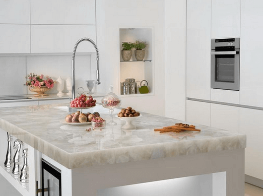 White Quartz Kitchen Island Countertop in a White Modern Kitchen