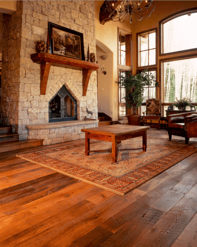 Antique Hardwood Flooring In A Tuscan Style Living Room