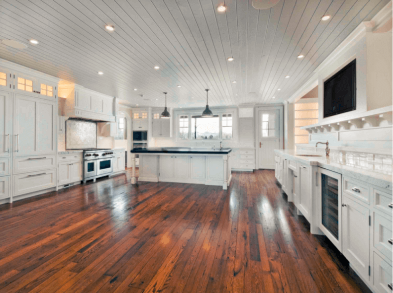 Antique Wood Flooring In A Traditional White Kitchen
