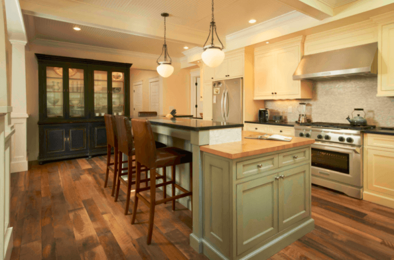 Reclaimed Ebony Wood Flooring In A Traditional Kitchen