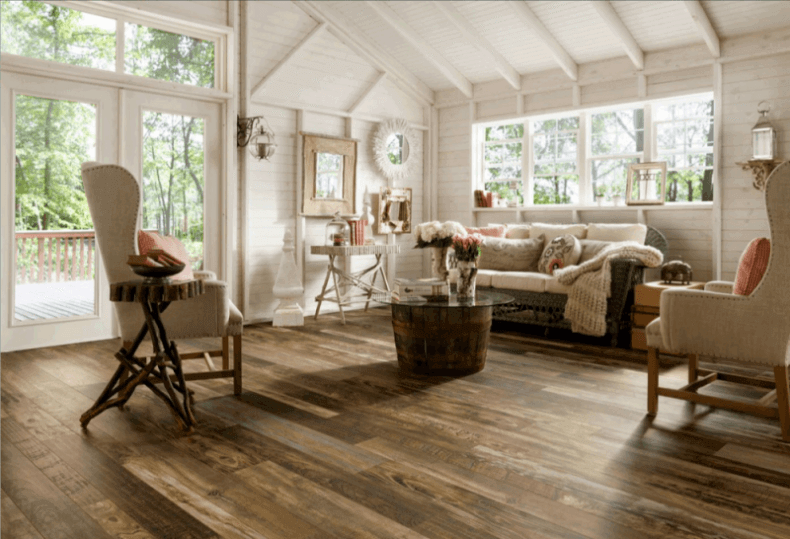 Reclaimed Hardwood Floors In A Farmhouse Style Living Room