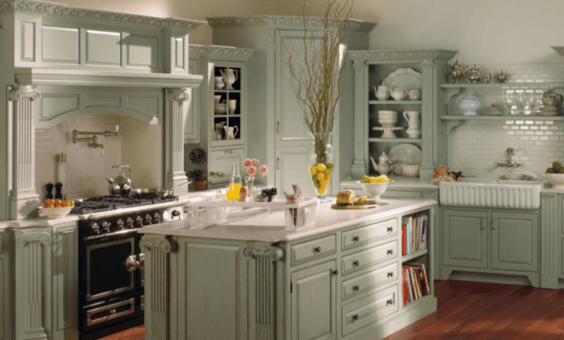 light green wood kitchen island in a french country style kitchen