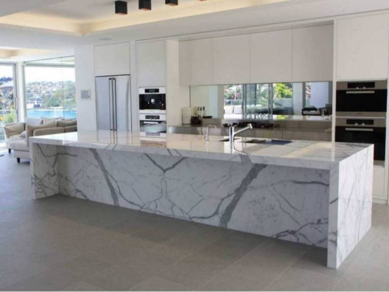 Superior Calcutta Marble Countertops In A Modern White Kitchen