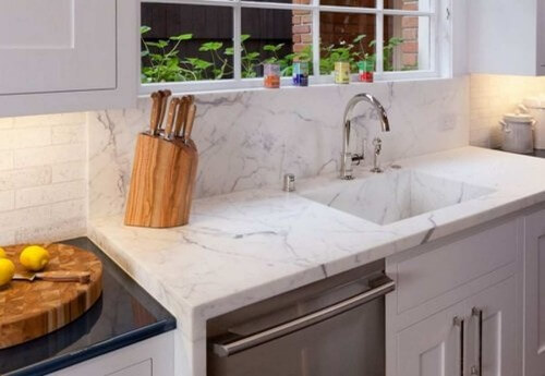 White Quartz Kitchen Sink Integrated With The Countertops
