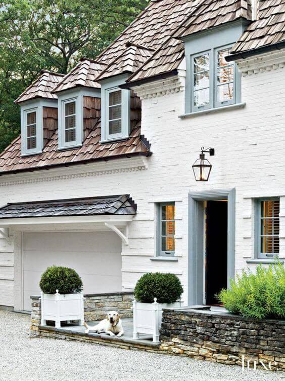 Cedar Shingles on a house with white brick siding