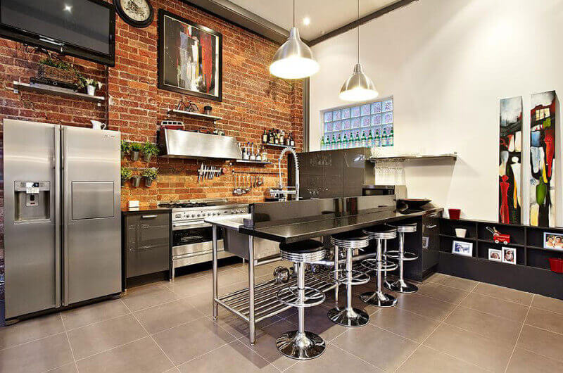 exposed brick wall in industrial style kitchen - Industrial Kitchen