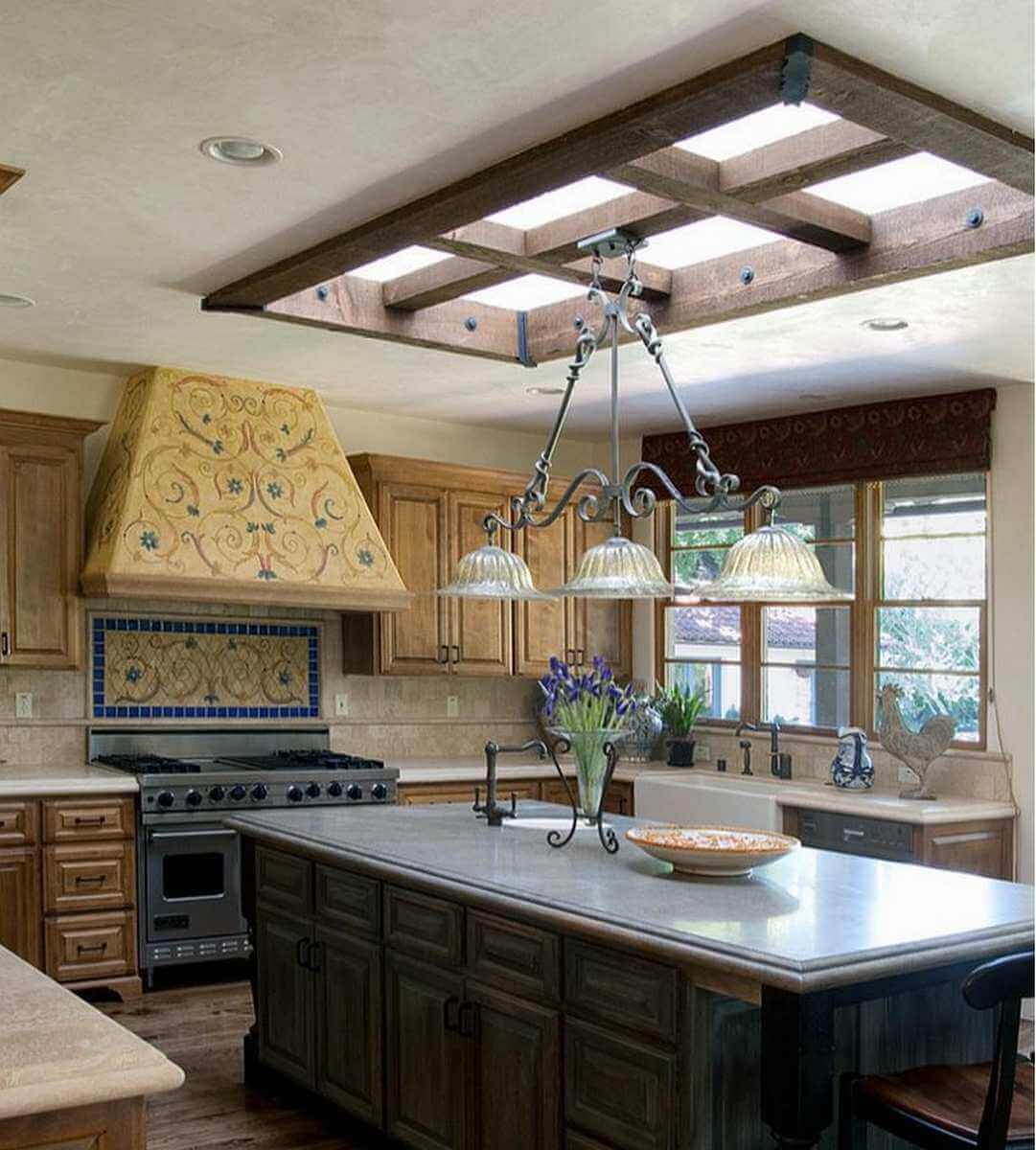 Fixed skylight in rustic tuscan style kitchen