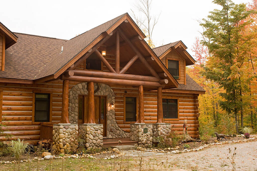 7 stunning wood siding types that will transform your home for Wood cabin homes
