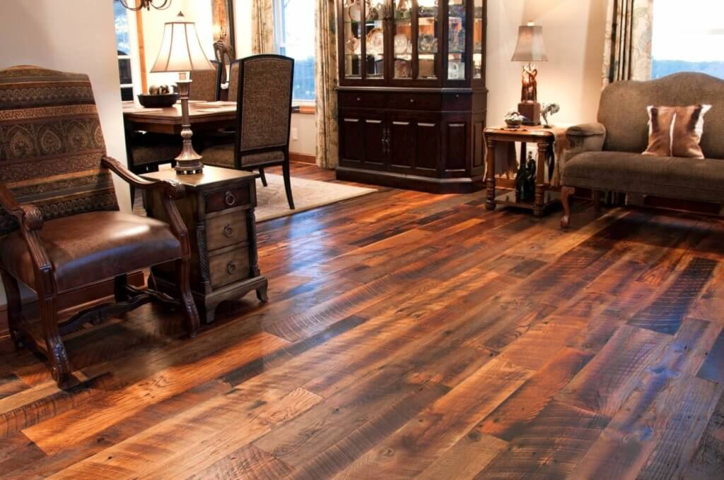 Reclaimed Hardwood Floors In a traditional living room