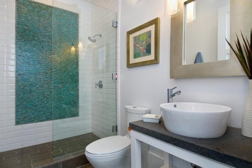 green mosaic tile accent shower wall